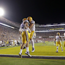 LSU tight end Logan Stokes (84) celebrates his touchdown reception with tight end Travis Dickson (41) during the second half of an NCAA college football game against Mississippi in Baton Rouge, La., Saturday, Oct. 25, 2014. (AP Photo/Gerald Herbert)