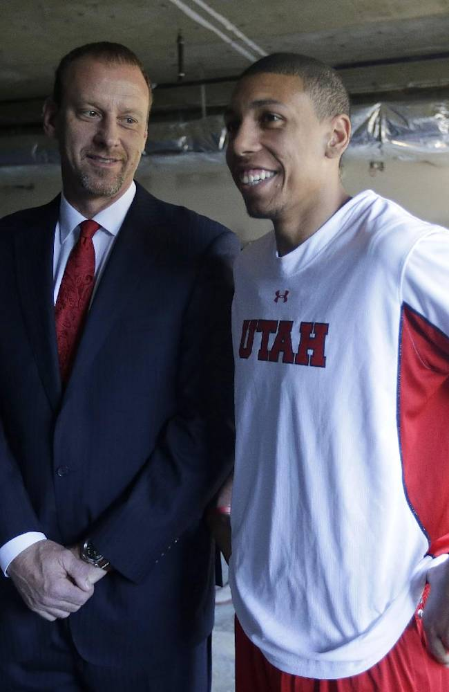 Utah coach Larry Krystkowiak, left, and player Jordan Loveridge chat as they prepare to field questions during the Pac-12 NCAA college basketball media day, Thursday, Oct. 17, 2013, in San Francisco
