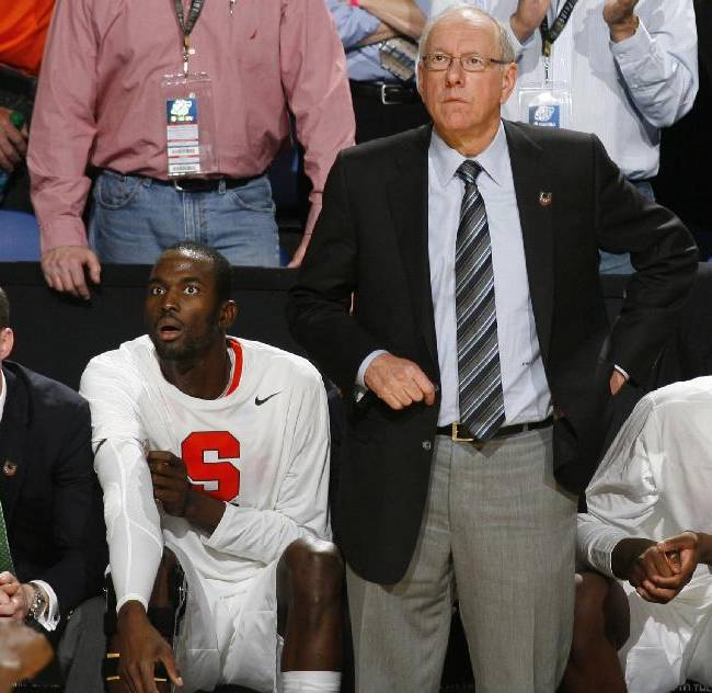 Syracuse head coach Jim Boeheim and his players on the bench watch their team play during the second half of a second-round game against Western Michigan in the NCAA college basketball tournament in Buffalo, N.Y., Thursday, March 20, 2014