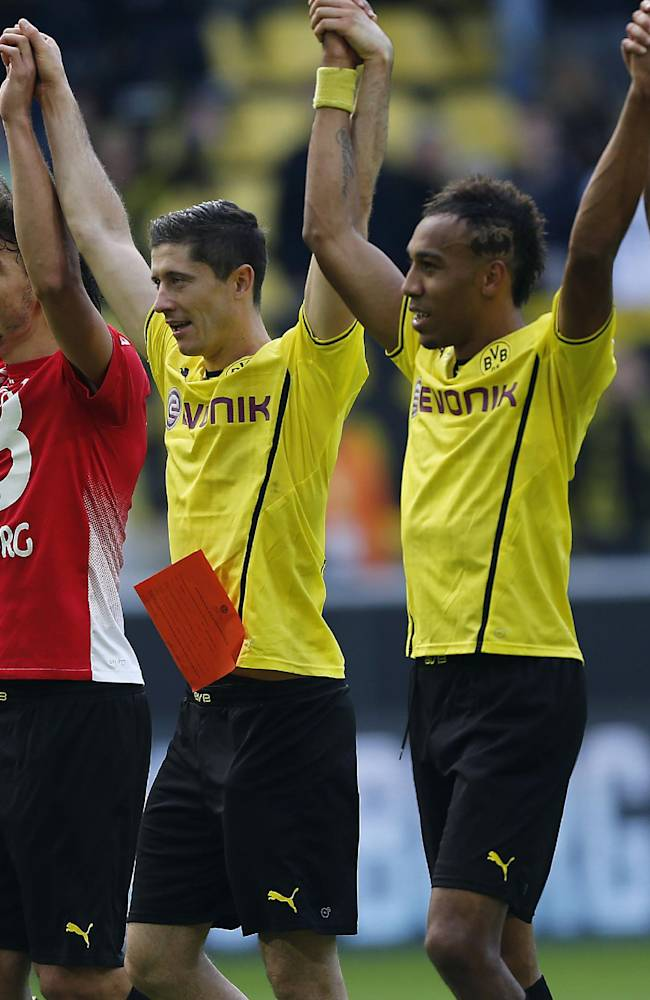 Dortmund teammates celebrate after winning the German first division Bundesliga soccer match between BvB Borussia Dortmund and SC Freiburg in Dortmund, Germany, Saturday, Sept. 28, 2013. Dortmund won by 5-0