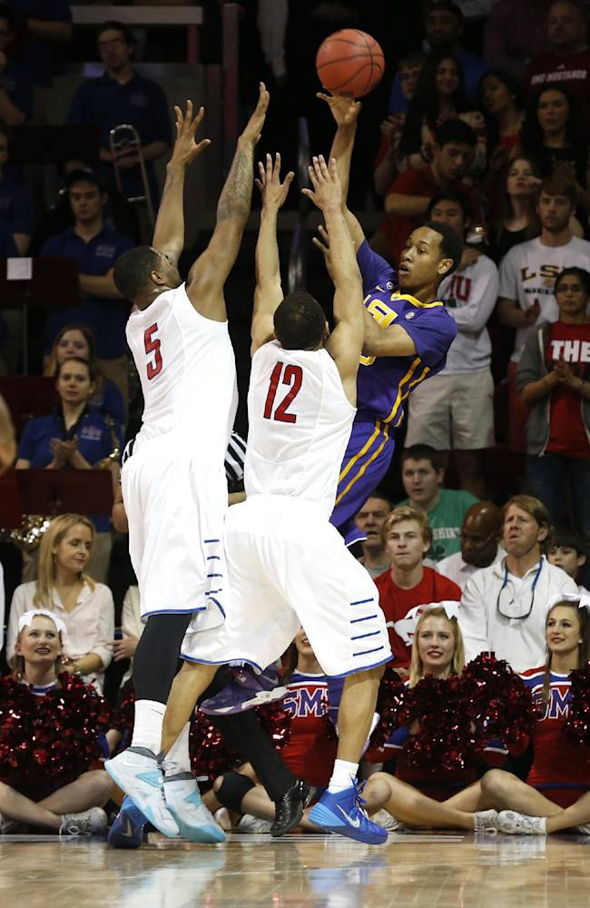 LSU guard Tim Quarterman (55) passes the ball out of coverage by SMU forward Markus Kennedy (5) and guard Nick Russell (12) during the second half of an NCAA college basketball game in the second round of the NIT Monday, March 24, 2014, in Dallas, Texas