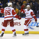 Detroit Red Wings center Pavel Datsyuk, right, celebrates with defenseman Danny DeKeyser after scoring the game-winning goal with 2.2 seconds remaining in overtime against the St. Louis Blues in an NHL hockey game Thursday, Jan. 15, 2015, in St. Louis. Th