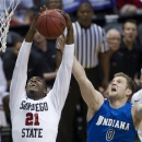San Diego State guard Jamaal Franklin (21) grabs a rebound away from Indiana State forward Jake Kitchell (0) in the first half of an NCAA college basketball game in the Diamond Head Classic, Sunday, Dec. 23, 2012, in Honolulu. (AP Photo/Eugene Tanner)
