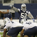 In this June 19, 2014, file photo, Dallas Cowboys outside linebackers Justin Durant (52) and Bruce Carter (54) line up during NFL football minicamp at the team's stadium in Arlington, Texas. Durant, signed as a free agent last year, is the top in-house c