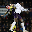 West Ham United's James Collins, left, attempts to clear the ball as Everton's Romelu Lukaku challenges during their English FA Cup third round replay soccer match between West Ham United and Everton at the Boleyn Ground stadium in London, Tuesday, Jan.