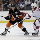 Anaheim Ducks defenseman Cam Fowler, left, battles Phoenix Coyotes left wing Rob Klinkhammer for the puck during the second p
