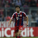Bayern's Xabi Alonso plays the ball during the Champions League Group E soccer match between FC Bayern Munich and Manchester City at Allianz Arena in Munich, southern Germany, Wednesday Sept. 17, 2014