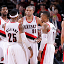 The Portland Trail Blazers stand on the court during a game against the Denver Nuggets on March 1, 2014 at the Moda Center Arena in Portland, Oregon. (Photo by Sam Forencich/NBAE via Getty Images)