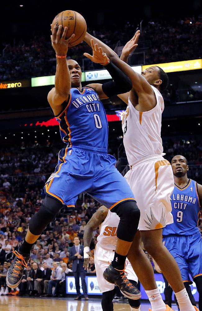 Oklahoma City Thunder guard Russell Westbrook (0) drives as Phoenix Suns forward Channing Frye (8) defends during the first half of an NBA basketball game on Sunday, April 6, 2014,in Phoenix