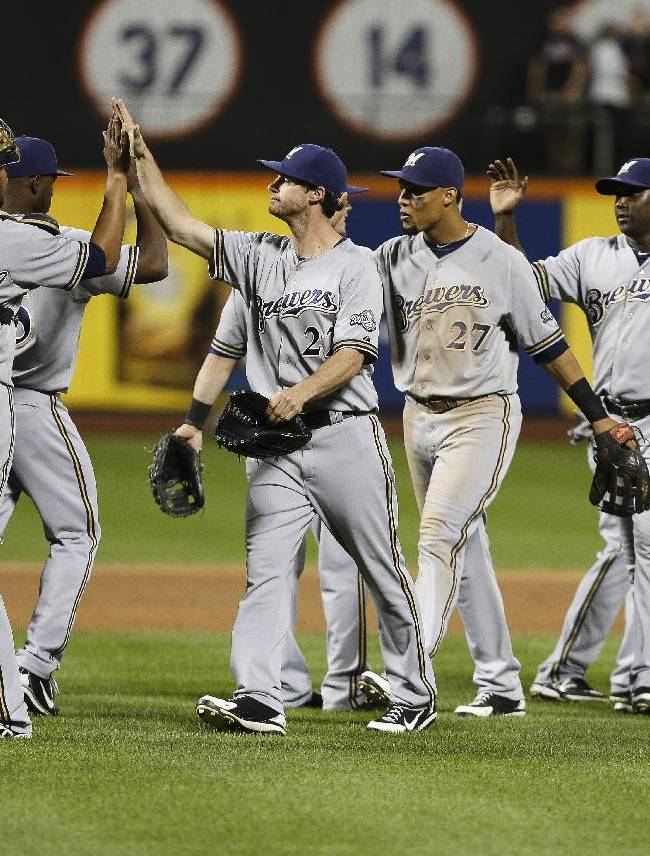 The Milwaukee Brewers celebrate their 4-2 victory over the New York Mets after a baseball game at Citi Field, Saturday, Sept. 28, 2013, in New York