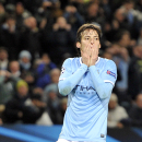 Manchester City's David Silva reacts after he sees his shot on goal saved, during their Champions League Round of 16 soccer match against Barcelona at the Etihad Stadium in Manchester, England, Tuesday, Feb. 18, 2014