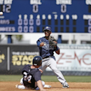 Tampa Bay Rays second baseman Cole Figueroa, top, puts out New York Yankees' Brian McCann (34) after Yankees; Alfonso Soriano grounded into a fourth-inning, inning-ending double play in a spring training baseball game in Tampa, Fla., Sunday, March 9, 2014