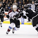 Colorado Avalanche's Nathan MacKinnon, left, is defended by Los Angeles Kings' Drew Doughty during the first period of an NHL hockey game on Saturday, Nov. 23, 2013, in Los Angeles The Associated Press