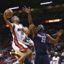 Charlotte Bobcats players Cody Zeller (40) and Al Jefferson (25) try to block Miami Heat's Shane Battier (31) during the first half of an NBA basketball game in Miami, Monday, March 3, 2014 The Associated Press