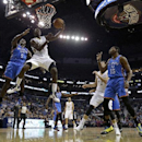 CORRECTS TO PELICANS' JRUE HOLIDAY NOT TYREKE EVANS - New Orleans Pelicans point guard Jrue Holiday (11) goes to the basket in front of Oklahoma City Thunder center Kendrick Perkins (5) as Pelicans center Jason Smith (14) tries to box out Thunder small fo