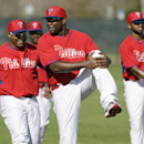 Philadelphia Phillies first baseman Ryan Howard, center, stretches with teammates during spring training baseball practice Wednesday, Feb. 19, 2014, in Clearwater, Fla The Associated Press