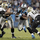 Carolina Panthers' DeAngelo Williams (34) tries to run between New Orleans Saints' Curtis Lofton (50) and Cameron Jordan (94) in the second half of an NFL football game in Charlotte, N.C., Thursday, Oct. 30, 2014 The Associated Press