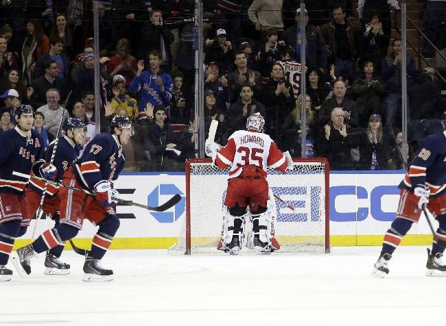 New York Rangers' Chris Kreider (20) skates past Detroit Red Wings goalie Jimmy Howard (35) after scoring a goal during the third period of an NHL hockey game on Sunday, March 9, 2014, in New York. The Rangers won the game 3-0