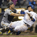 Milwaukee Brewers' Carlos Gomez, right, is tagged out at home by Pittsburgh Pirates' Tony Sanchez during the seventh inning of a baseball game on Sunday, April 13, 2014, in Milwaukee The Associated Press