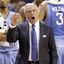 North Carolina head coach Roy Williams directs his team against Davidson during the first half of an NCAA college basketball game in Charlotte, N.C., Saturday, Nov. 22, 2014. (AP Photo/Chuck Burton)