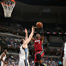 MEMPHIS, TN - OCTOBER 24: Chris Bosh #1 of the Miami Heat shoots against the Memphis Grizzlies on October 24, 2014 at FedExForum in Memphis, Tennessee. (Photo by Joe Murphy/NBAE via Getty Images)