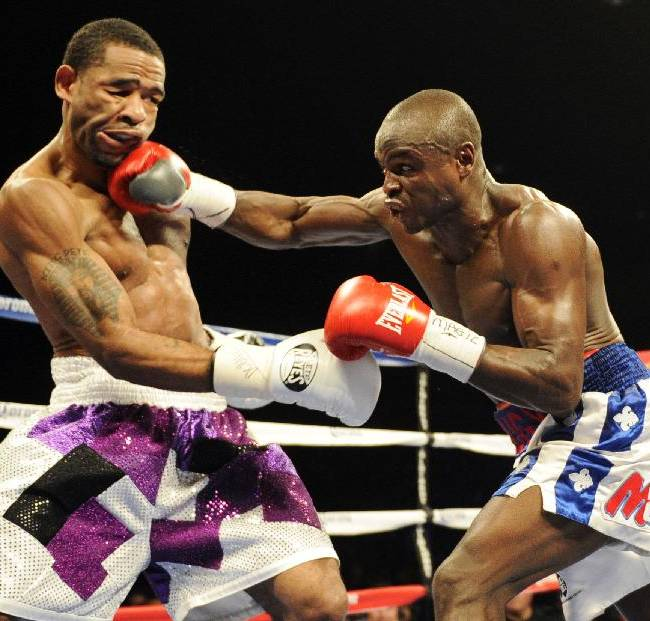 Dierry Jean, of Canada, right, hits Lamont Peterson during the IBF Junior welterweight title boxing match, Saturday, Jan. 25, 2014, in Washington. Peterson won the match