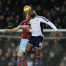 West Ham United's James Collins, left, and West Bromwich Albion's Victor Anichebe battle for the ball during the English Premier League soccer match against West Bromwich Albion at The Hawthorns, West Bromwich, England, Tuesday Dec. 2, 2014