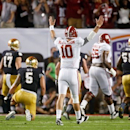 Alabama's AJ McCarron reacts to a touchdown run by Eddie Lacy during the first half of the BCS National Championship college football game against Notre Dame Monday, Jan. 7, 2013, in Miami. (AP Photo/John Bazemore)