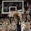 In this Jan. 29, 2014 file photo, Penn State's DJ Newbill (2) makes the game-winning shot as Ohio State's Aaron Craft (4) and Sam Thompson (12) defend during overtime of an NCAA college basketball game in Columbus, Ohio. Having regained some momentum afte
