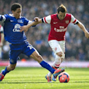 Arsenal's Santi Cazorla, right, fights for the ball with Everton's Steven Pienaar, during their FA Cup quarterfinal soccer match, at Emirates Stadium, in London, Saturday, March 8, 2014