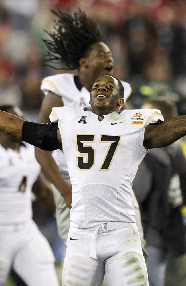 Central Florida linebacker Troy Gray (57) celebrates as time expires after the Fiesta Bowl NCAA college football game against Baylor, Wednesday, Jan. 1, 2014, in Glendale, Ariz. Central Florida won 52-42
