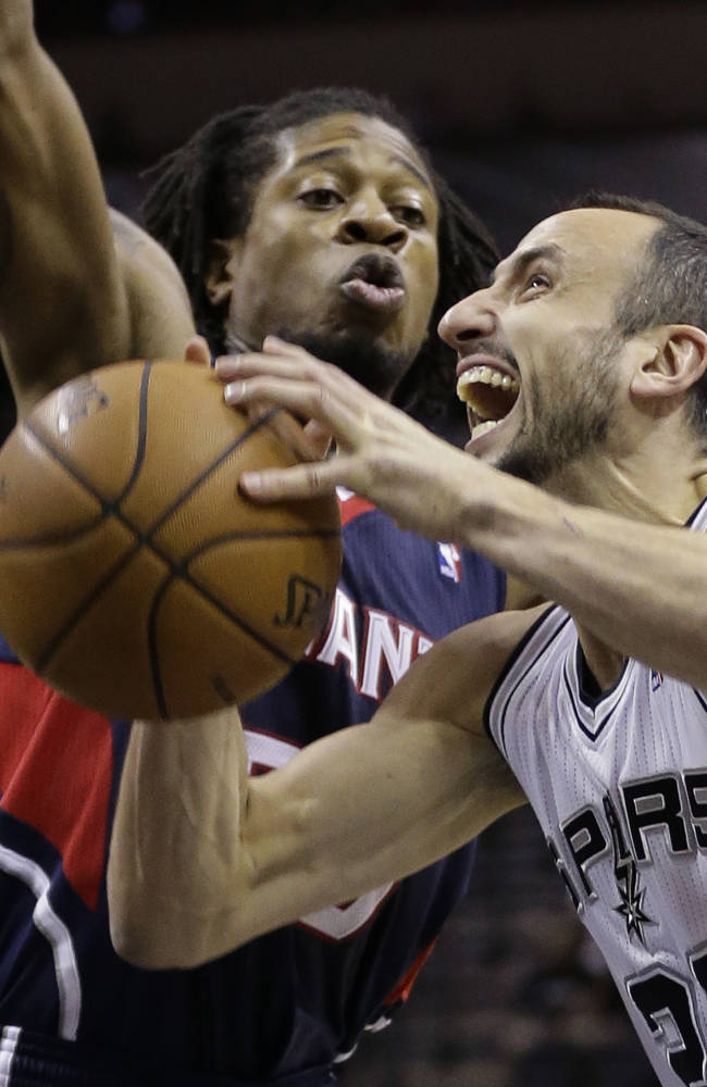Duncan's jumper lifts Spurs over Hawks 102-100