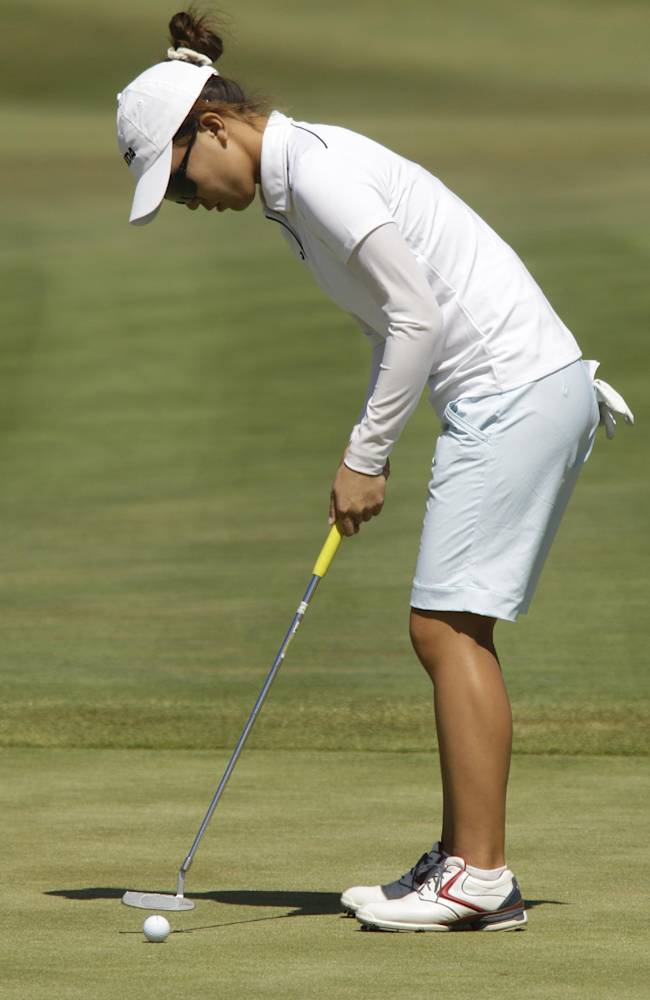 Teresa Lu, of Taiwan, putts on the 18th hole at the first round of the LPGA Safeway Classic golf tournament at Pumpkin Ridge Friday, Aug. 20, 2010, in North Plains, Ore