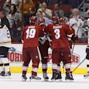 Boston Bruins' Johnny Boychuk (55) and Andrej Meszaros (41), of the Czech Republic, skate away as Phoenix Coyotes' Shane Doan (19) celebrates his goal with teammates Keith Yandle (3), Mike Ribeiro (63) and Brandon McMillan (38) during the first period of