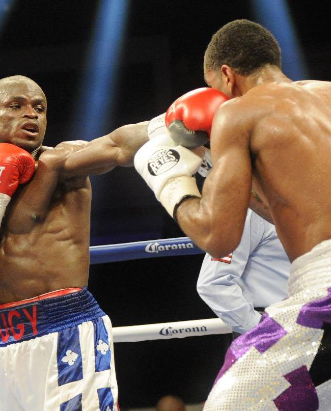 Dierry Jean, left, of Canada, punches Lamont Peterson, right, during the IBF Junior welterweight title boxing match, Saturday, Jan. 25, 2014, in Washington. Peterson won the match