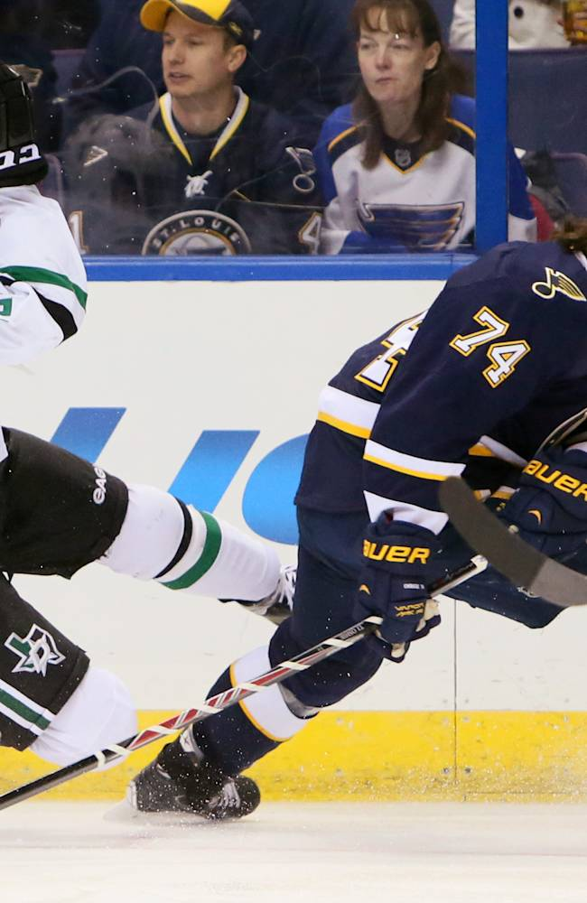 Dallas Stars right wing Alex Chiasson (left) collides with St. Louis Blues right wing T.J. Oshie in first period action during a game between the St. Louis Blues and the Dallas Stars on Saturday, Nov. 23, 2013, in St. Louis