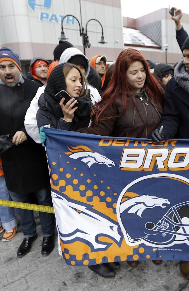 Denver Broncos fans wait for the players to arrive at the team hotel Sunday, Jan. 26, 2014, in Jersey City, N.J. The Broncos are scheduled to play the Seattle Seahawks in the NFL Super Bowl XLVIII football game Sunday, Feb. 2, in East Rutherford, N.J