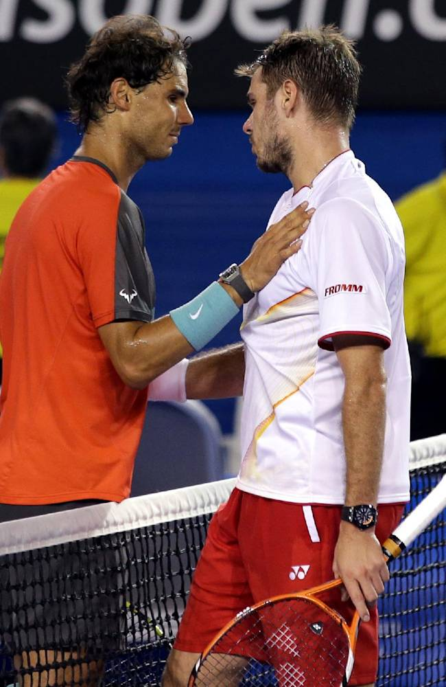 Stanislas Wawrinka of Switzerland, right, is celebrated by Rafael Nadal of Spain at the net after Wawrinka won during the men's singles final at the Australian Open tennis championship in Melbourne, Australia, Sunday, Jan. 26, 2014