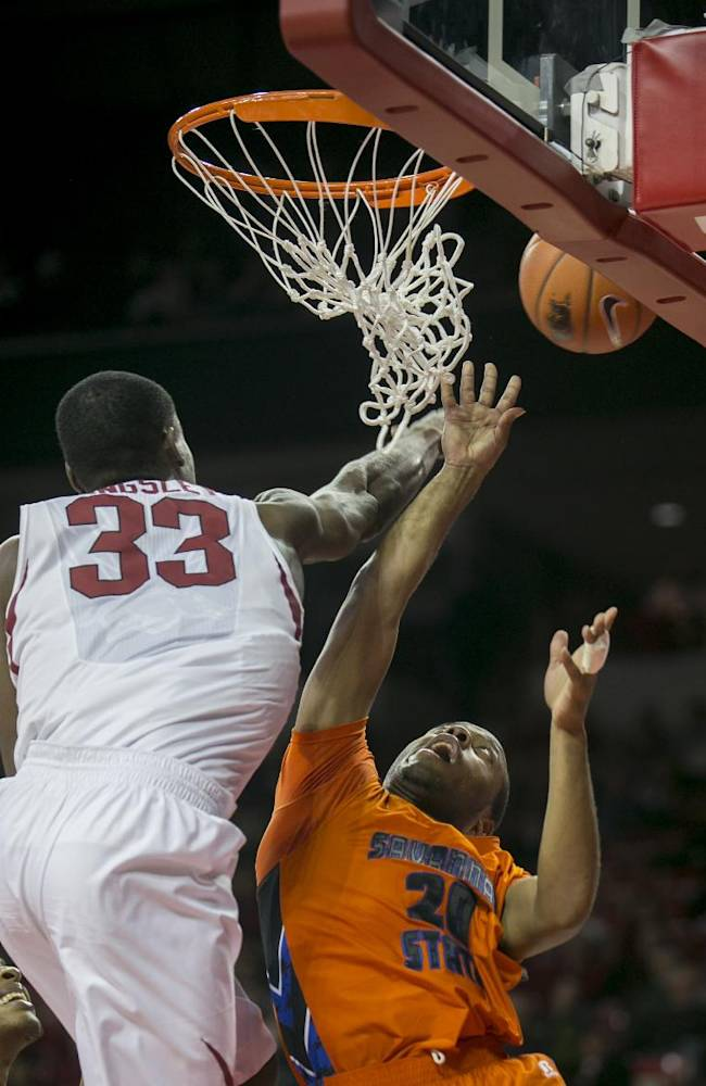 Arkansas center Moses Kingsley, 33, blocks Savannah State guard Deven Williams during the second half of a NCAA college basketball game Thursday, Dec. 12, 2013 at Bud Walton Arena in Fayetteville, Ark. Arkansas defeated Savannah State 72-43