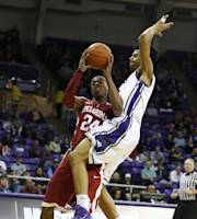 Oklahoma guard Buddy Hield (24) is fouled on his way to the basket by TCU center Karviar Shepherd in the first half of an NCAA basketball game Saturday, March 8, 2014, in Fort Worth, Texas. Oklahoma won 97-67. (AP Photo/Sharon Ellman)