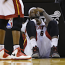 Miami Heat's LeBron James sits on the court after being elbowed by Charlotte Bobcats' Josh McRoberts during the second half in Game 2 of an opening-round NBA basketball playoff series, Wednesday, April 23, 2014, in Miami. The Heat defeated the Bobcats 101