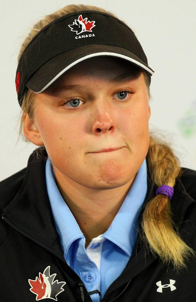 Canadian amateur Brooke Henderson answers questions at the Canadian Pacific Women's Open golf tournament in London, Ontario, Wednesday, Aug. 20, 2014