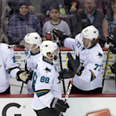 San Jose Sharks defenseman Brent Burns (88) celebrates his goal against the Vancouver Canucks with his teammates during the second period of an NHL preseason hockey game in Vancouver, British Columbia, Tuesday, Sept. 23, 2014. The Associated Press