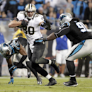 New Orleans Saints' Jimmy Graham (80) runs past Carolina Panthers' Colin Cole (91) in the second half of an NFL football game in Charlotte, N.C., Thursday, Oct. 30, 2014 The Associated Press