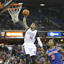 Sacramento Kings guard Ben McLemore (16) breaks away for a dunk against New York Knicks defender J.R. Smith (8) during the second half of an NBA basketball game in Sacramento, Calif., on Wednesday, March 26, 2014.The Knicks won 107-99 The Associated Press