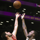 Brooklyn Nets center Andray Blatche (0), right, shoots against Houston Rockets forward Omri Casspi (18) during the first half of their NBA basketball game at the Barclays Center, Tuesday, April 1, 2014, in New York The Associated Press