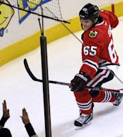 Chicago Blackhawks' Andrew Shaw (65) celebrates after scoring the game-winning goal during overtime of an NHL preseason hockey game against the Washington Capitals in Chicago, Saturday, Sept. 28, 2013. The Blackhawks won 4-3. (AP Photo/Nam Y. Huh)
