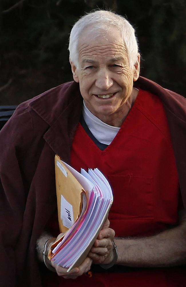 In this Jan. 10, 2013, file photo, former Penn State assistant football coach Jerry Sandusky arrives at the Centre County Courthouse for a post-sentencing hearing in Bellefonte, Pa. A new accuser is suing Sandusky, Penn State and a charity the former assistant coach founded, saying he was sexually abused about six years ago. The Centre Daily Times reported Wednesday, Sept. 3, 2014,that the case was filed in Philadelphia last month by Williamsport, Pa., attorney Bret Southard