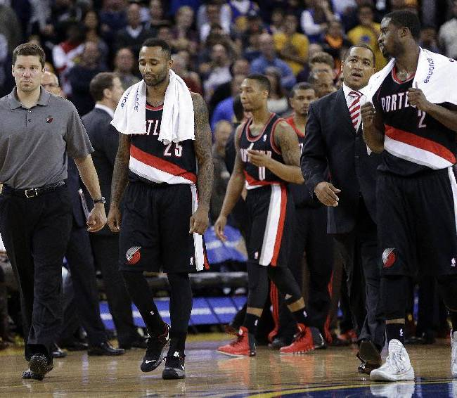 Portland Trail Blazers' Mo Williams (25) and Wesley Matthews (2) walk off the court after being ejected from an NBA basketball game against the Golden State Warriors Saturday, Nov. 23, 2013, in Oakland, Calif