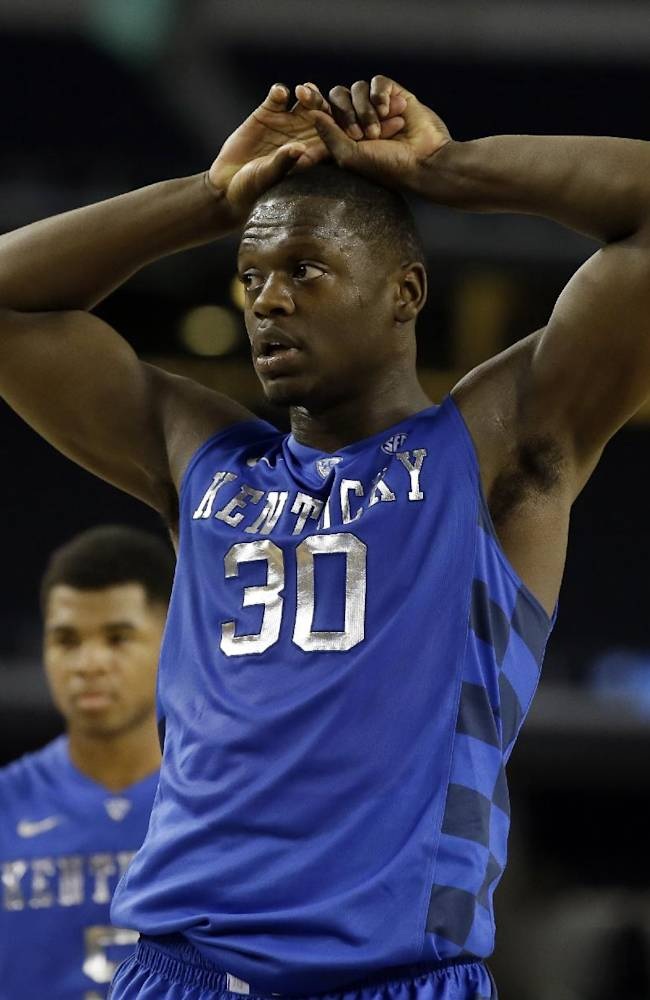 Kentucky forward Julius Randle (30) places his hands on his head after missing the first of two free throws late in the second half of an NCAA college basketball game against Baylor as Andrew Harrison, rear, watches , Saturday, Dec. 7, 2013, in Arlington, Texas. Baylor upset Kentucky 67-62